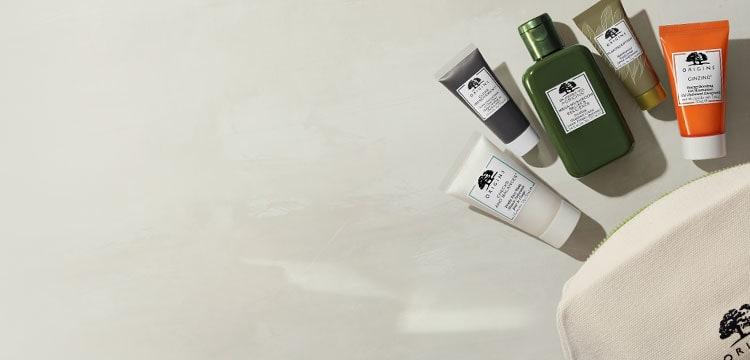 Ensemble découverte Origins le plus populaire avec 5 produits de mini soins de la peau et un sac à cosmétiques ivoire renversé
